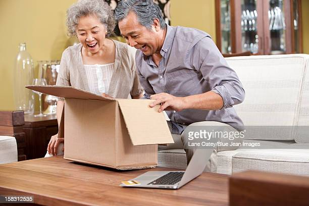 Senior couple receiving their online purchase