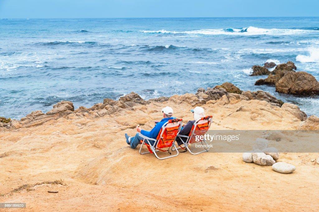 Senior Rela At Asilomar Beach In Monterey California Stock Photo