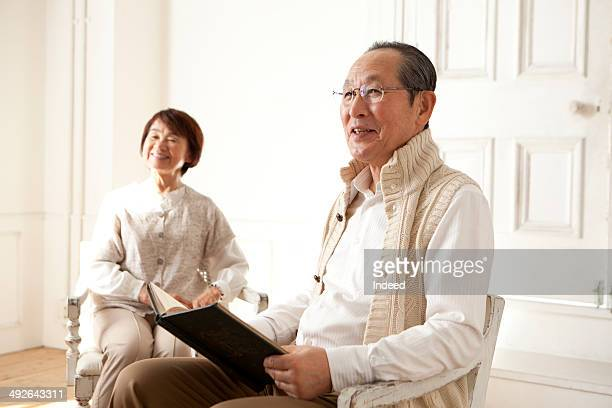 Senior couple relaxing in living room