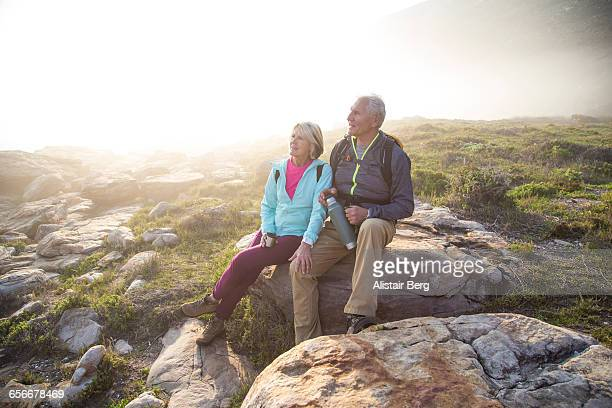 senior couple relaxing outdoors together - outdoor pursuit stock pictures, royalty-free photos & images