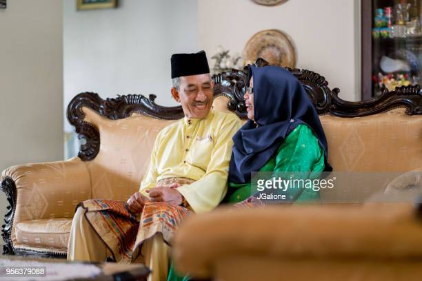 Senior couple relaxing together at home