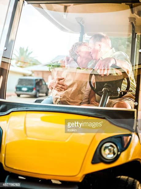 Senior couple returning home after shopping
