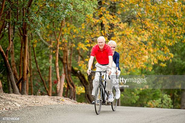 Senior Couple Riding a Tandem Bike