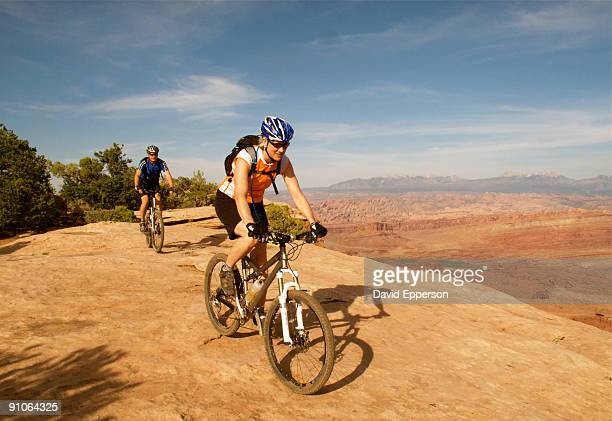 senior couple riding mountain bikes in utah - dead horse point state park stock pictures, royalty-free photos & images