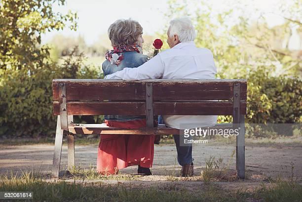 Senior Couple Romantic on a park bench.