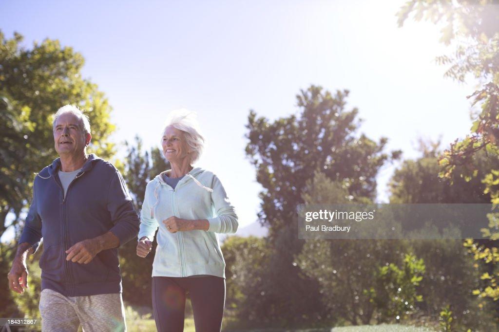 Senior couple running in park : Stock Photo