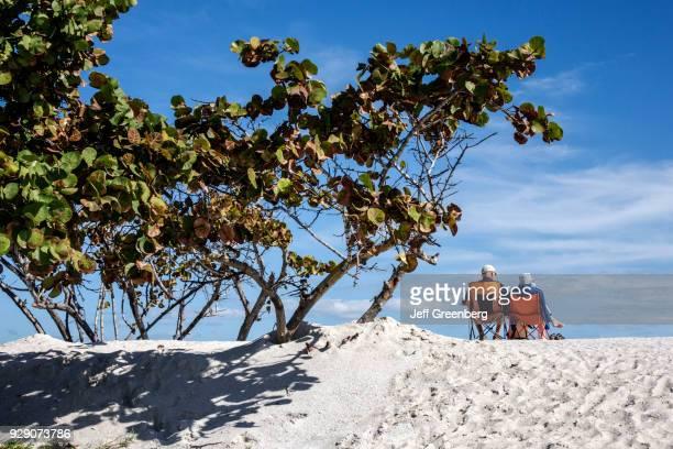 Senior couple sat on chairs on Bathtub Reef Beach.