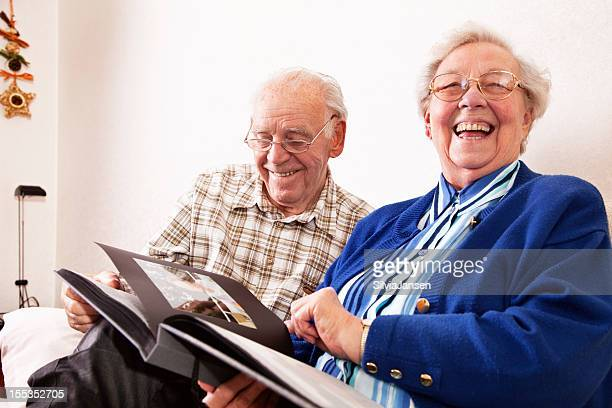 senior couple sharing happy memories at home - remembrance stock photos and pictures