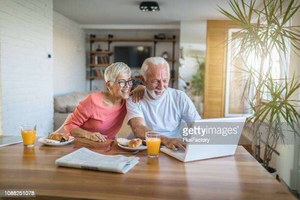 senior couple shopping online - candid forum stock pictures, royalty-free photos & images