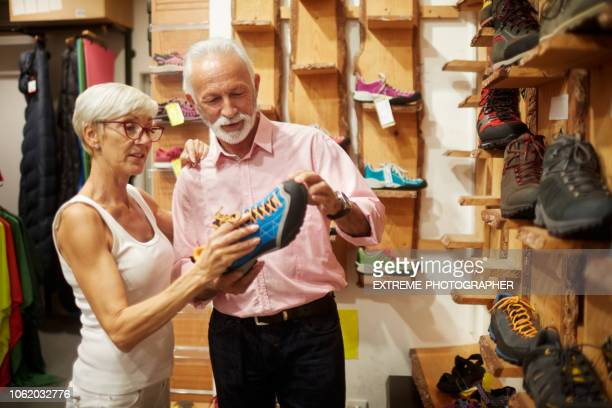 senior couple shopping - shoe store stock pictures, royalty-free photos & images