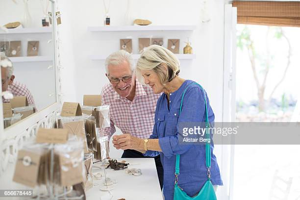 senior couple shopping together - gift shop stock pictures, royalty-free photos & images