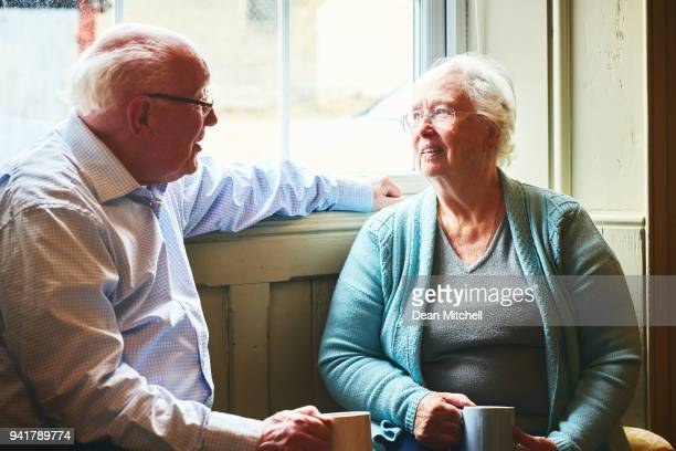 Senior couple sitting at home and talking