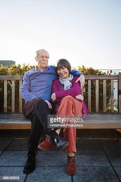 Senior Couple Sitting At Roofgarden