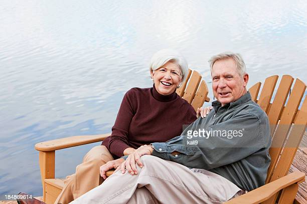 Senior couple sitting by water