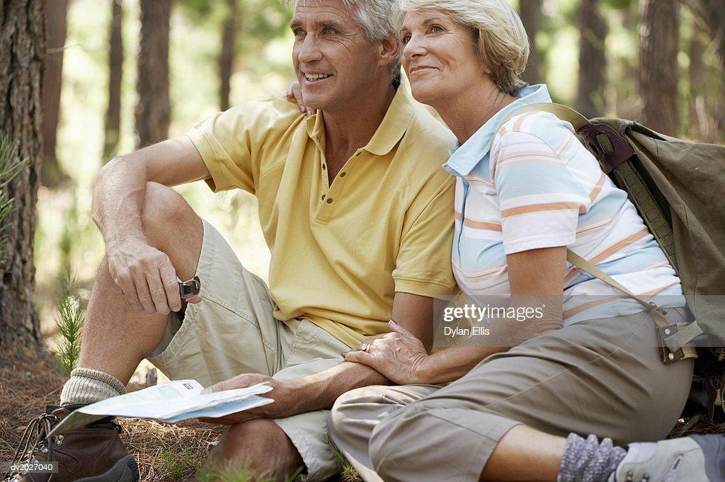 Senior Couple Sitting in a Forest : Stock Photo