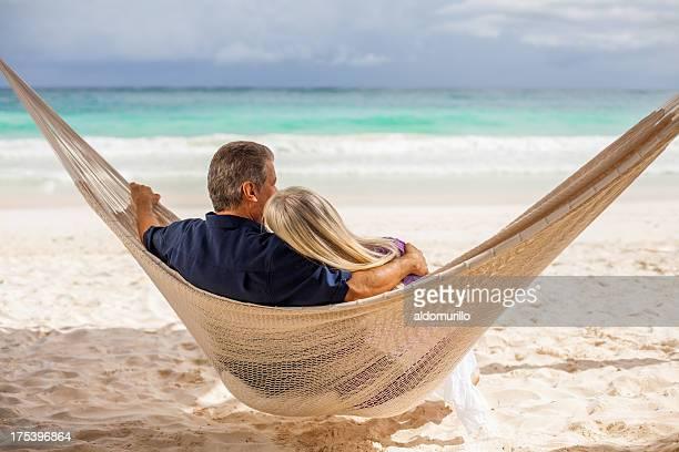Senior couple sitting in a hammock