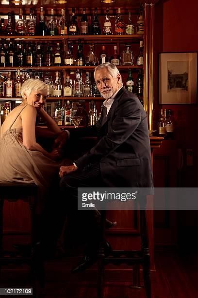 senior couple sitting in bar of cocktail lounge - health2010 ストックフォトと画像