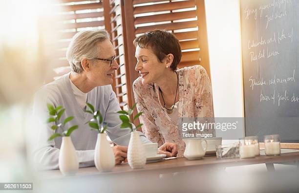 Senior couple sitting in restaurant