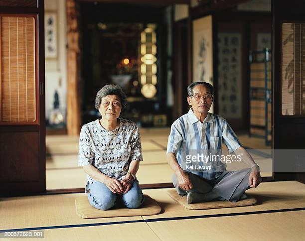 Senior couple sitting in temple, portrait