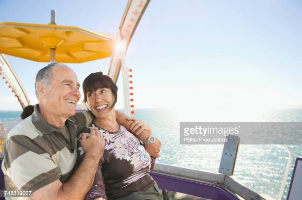 Senior couple sitting near ocean