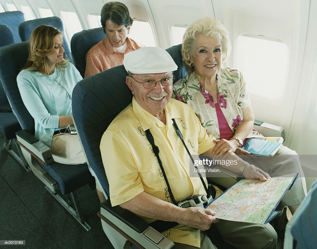 Senior Couple Sitting on a Plane : Stock Photo