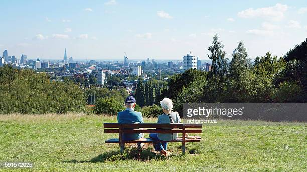 Senior couple sitting on bench at Parliament Hill