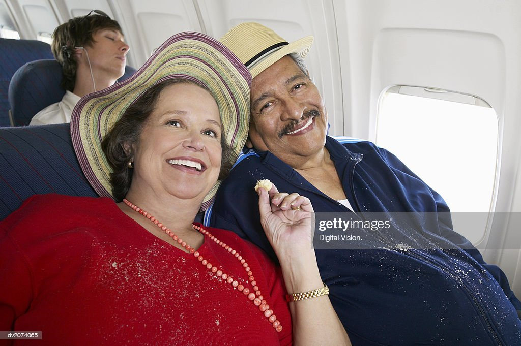 Senior Couple Sitting on Seats in an Aeroplane Cabin : Stock Photo