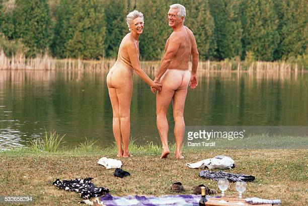senior couple skinny dipping - women skinny dipping stock pictures, royalty-free photos & images
