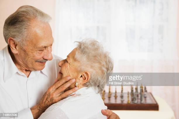senior couple smiling at each other - 69 position stock photos and pictures