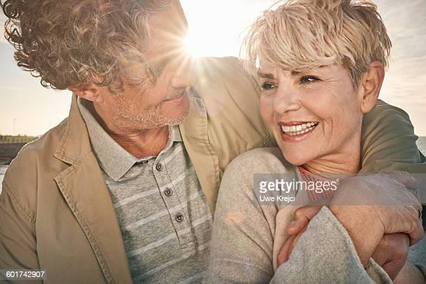 Senior couple smiling, close up