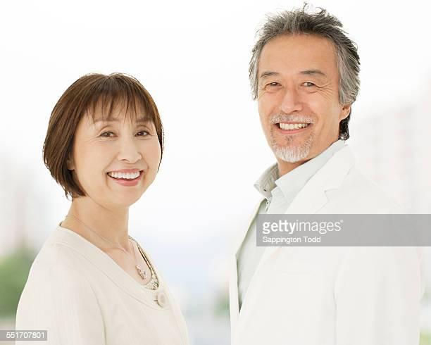 senior couple smiling - 60代 ストックフォトと画像