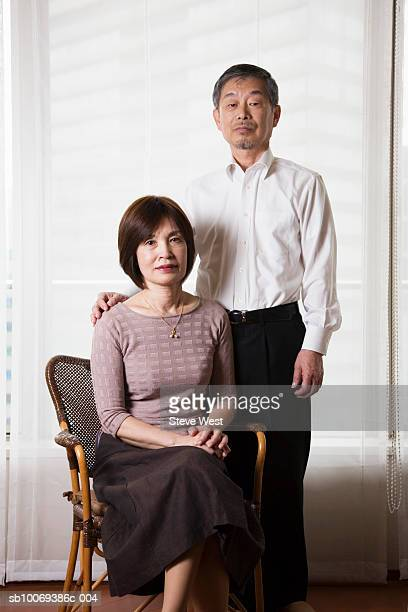 Senior couple smiling, portrait