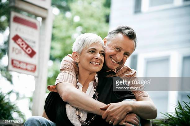 senior couple sold home - real estate sign stock pictures, royalty-free photos & images