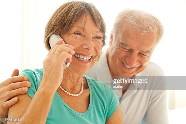 Senior couple speaking on the phone with their loved ones
