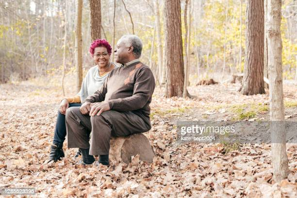 senior couple spending time outdoor - purple hair stock pictures, royalty-free photos & images