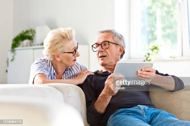 senior couple spending time together at home - discussion stock pictures, royalty-free photos & images