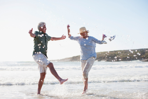 Senior couple splashing in ocean - gettyimageskorea