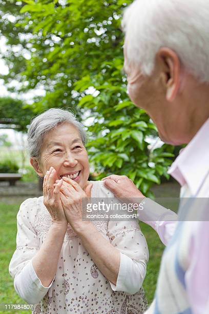 senior couple standing face to face, tokyo prefecture, honshu, japan - 肩越し ストックフォトと画像