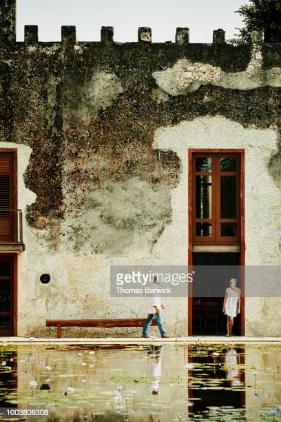 Senior couple standing in courtyard of luxury resort