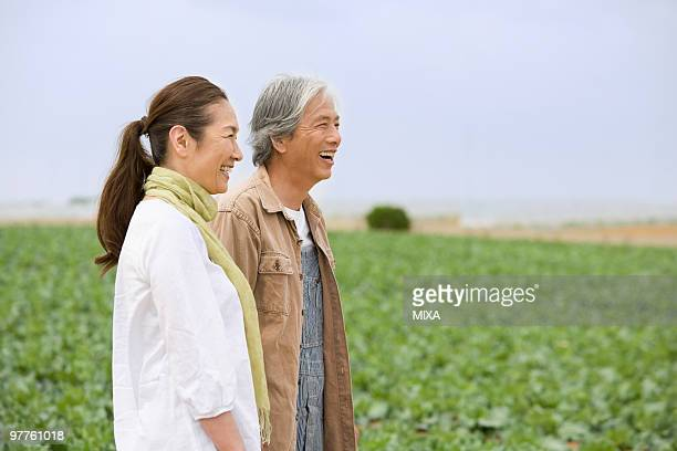 senior couple standing in field - kanagawa prefecture stock pictures, royalty-free photos & images