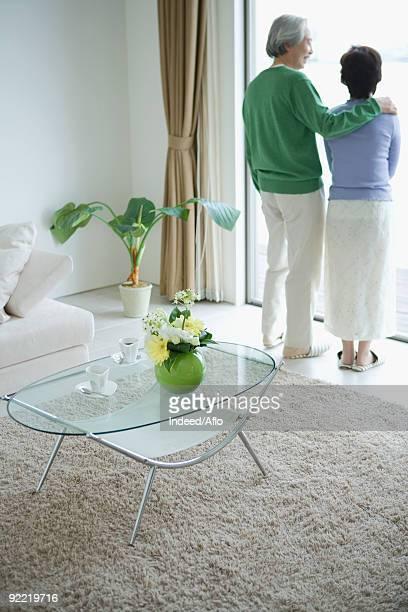 Senior couple standing in front door