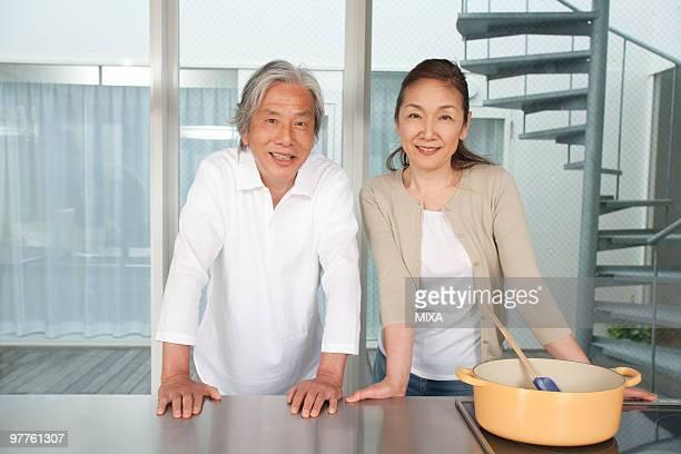 Senior couple standing in kitchen