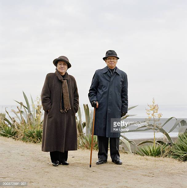 Senior couple standing outdoors, portrait
