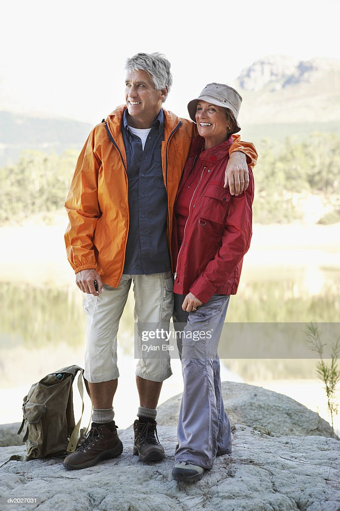 Senior Couple Standing Together on a Rocky Outcrop : Stock Photo