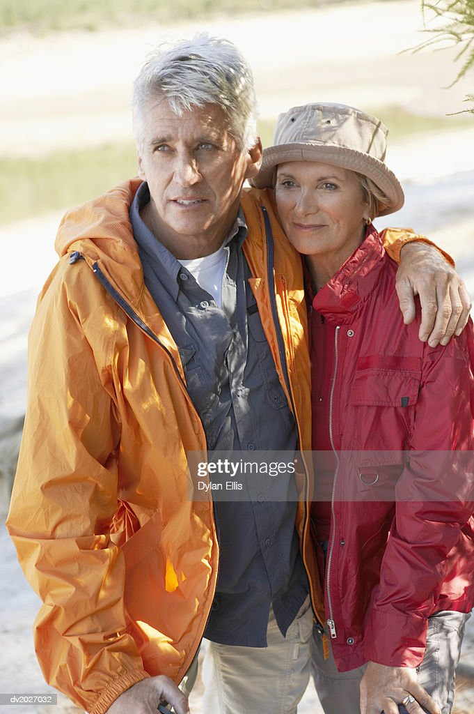 Senior Couple Standing Together, with the Man's Arm Around the Woman's Shoulders : Stock Photo