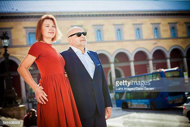 Senior couple stands on city street, Munich, Bavaria, Germany