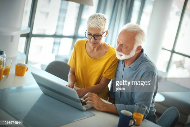 senior couple staying at home. - respiratory disease stock pictures, royalty-free photos & images