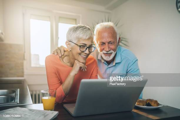 senior couple staying in touch with their family - candid forum stock pictures, royalty-free photos & images
