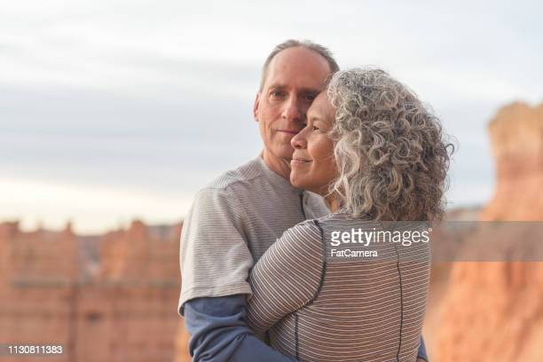 senior couple taking a break from hiking in the utah mountains - pacific islanders stock pictures, royalty-free photos & images