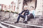 Senior couple taking a rest next to church, Tübingen, Germany